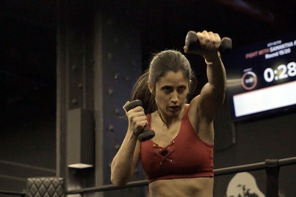 Jennifer Jacobs punching with weights