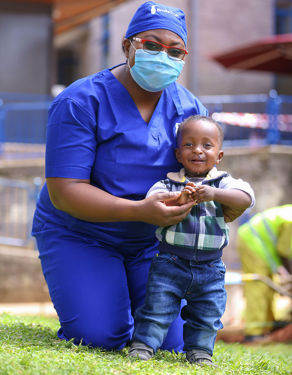 Dr. Malungo standing with a patient who had cleft lip and cleft palate surgery in Lusaka, Zambia.