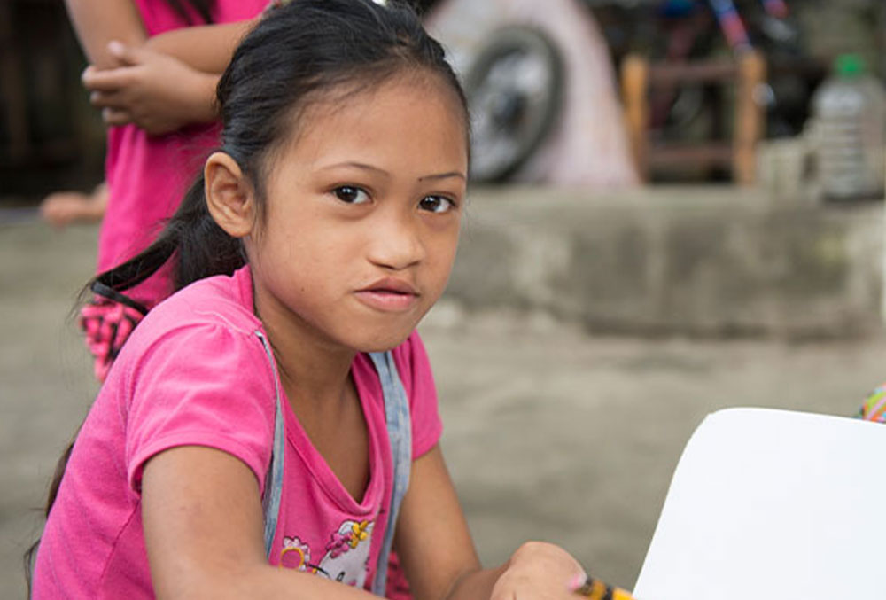 A Smile Train cleft patient writing