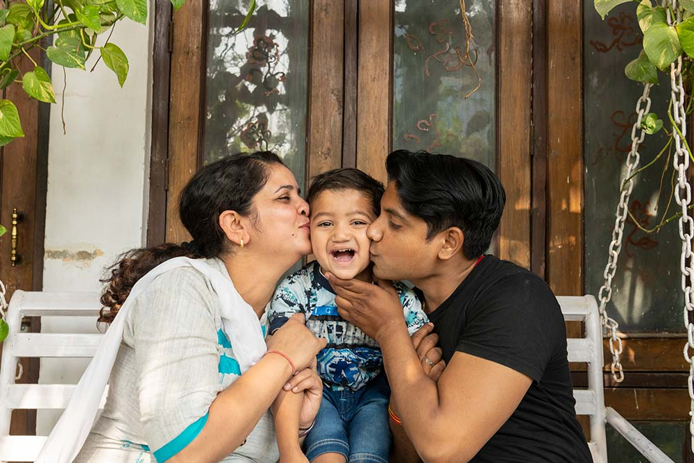 Saksham gets a kiss from mom and dad