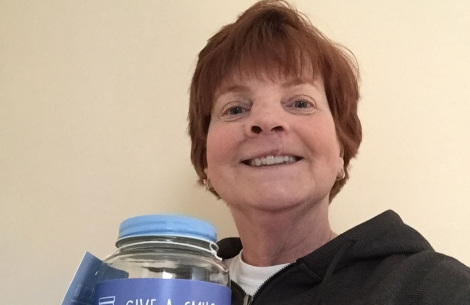 Patricia Simon with collection jar