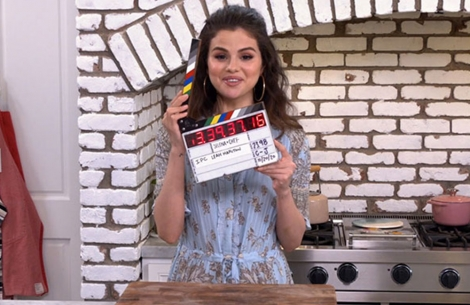 Selena Gomez holding a slate during her show, 'Selena + Chef'