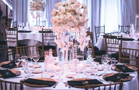 A wedding setting of plates and flowers