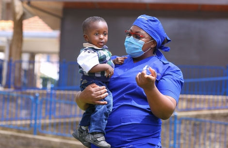 Dr. Amanda Malungo holding a cleft patient after his surgery.