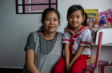 A school-aged Meng with her mother after cleft lip and cleft palate surgery in Cambodia