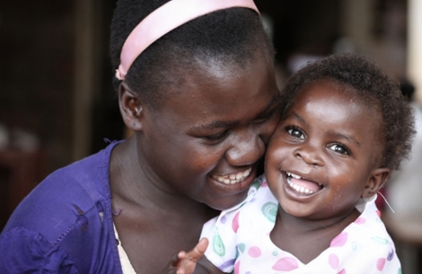 A mother with her child after her cleft lip and palate surgery