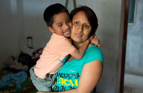 Anghelo hugs his mother after free cleft surgery in Peru