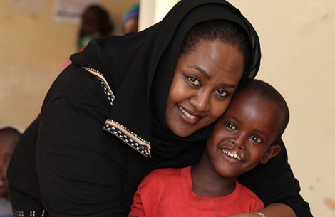 Sesnie hugging a boy after cleft lip and cleft palate surgery in Ethiopia