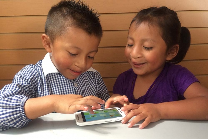 two children playing Smile Train speech therapy app