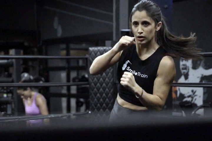 Jennifer Jacobs boxing in a Smile Train tanktop